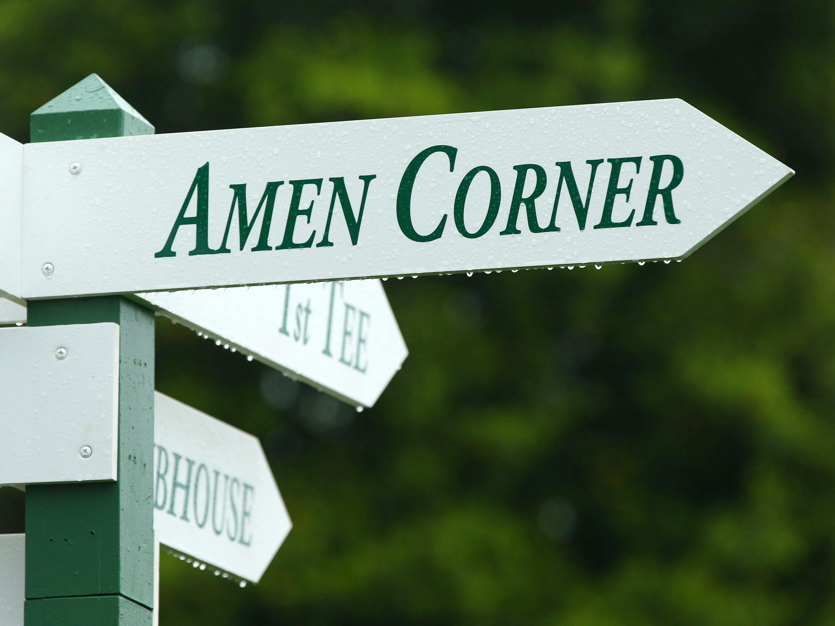 Apr 7, 2019; Augusta, GA, USA; Rain drops cover an 'Amen Corner' sign during the finals of the Drive, Chip and Putt competition at Augusta National Golf Club. Mandatory Credit: Rob Schumacher-USA TODAY Sports