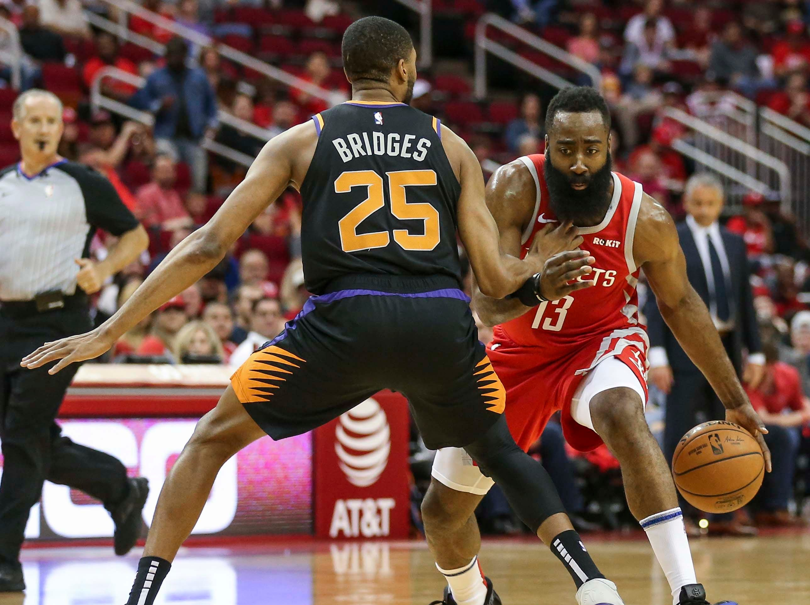 Apr 7, 2019; Houston, TX, USA; Phoenix Suns forward Mikal Bridges (25) defends against Houston Rockets guard James Harden (13) during the first quarter at Toyota Center. Mandatory Credit: Troy Taormina-USA TODAY Sports