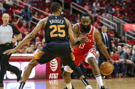 Suns forward Mikal Bridges defense Rockets guard James Harden during a game April 7 at Toyota Center.