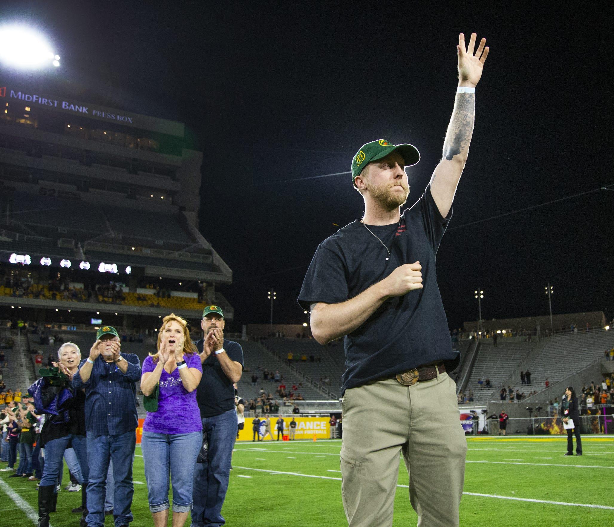 Brendan McDonough, the lone-surviving member of the Granite Mountain Hotshots, waves to the Arizona Hotshots crowd.