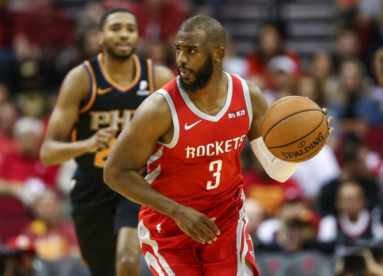Apr 7, 2019; Houston, TX, USA; Houston Rockets guard Chris Paul (3) dribbles the ball during the first quarter against the Phoenix Suns at Toyota Center. Mandatory Credit: Troy Taormina-USA TODAY Sports