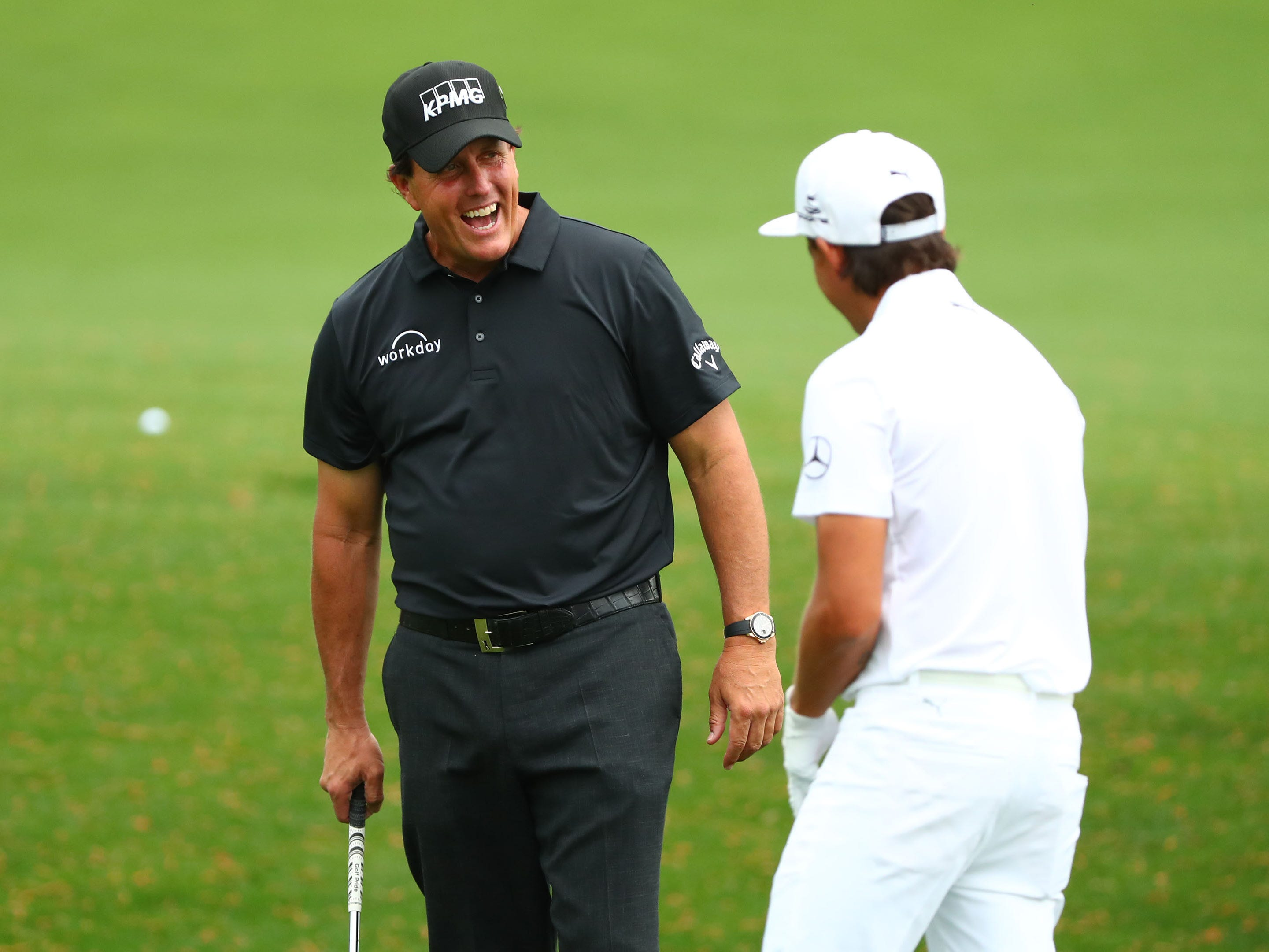 Apr 8, 2019; Augusta, GA, USA; Phil Mickelson (left) and Rickie Fowler talk at the practice facility during a practice round for the Masters golf tournament at Augusta National Golf Club.