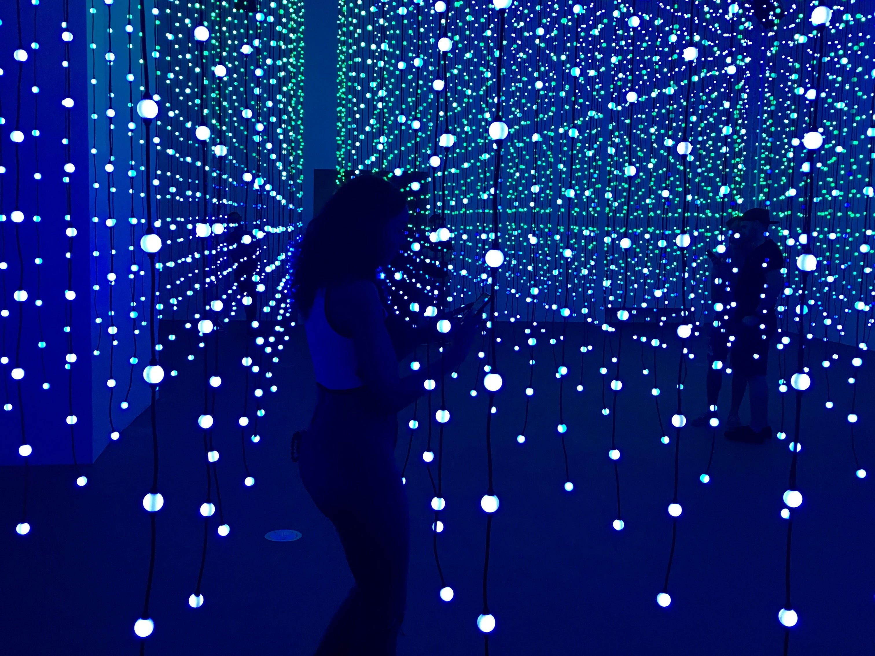 "Taelor Parker, 24, of Phoenix, explores the ""Submergence"" art installation at Wonderspaces Arizona on April 5, 2019."