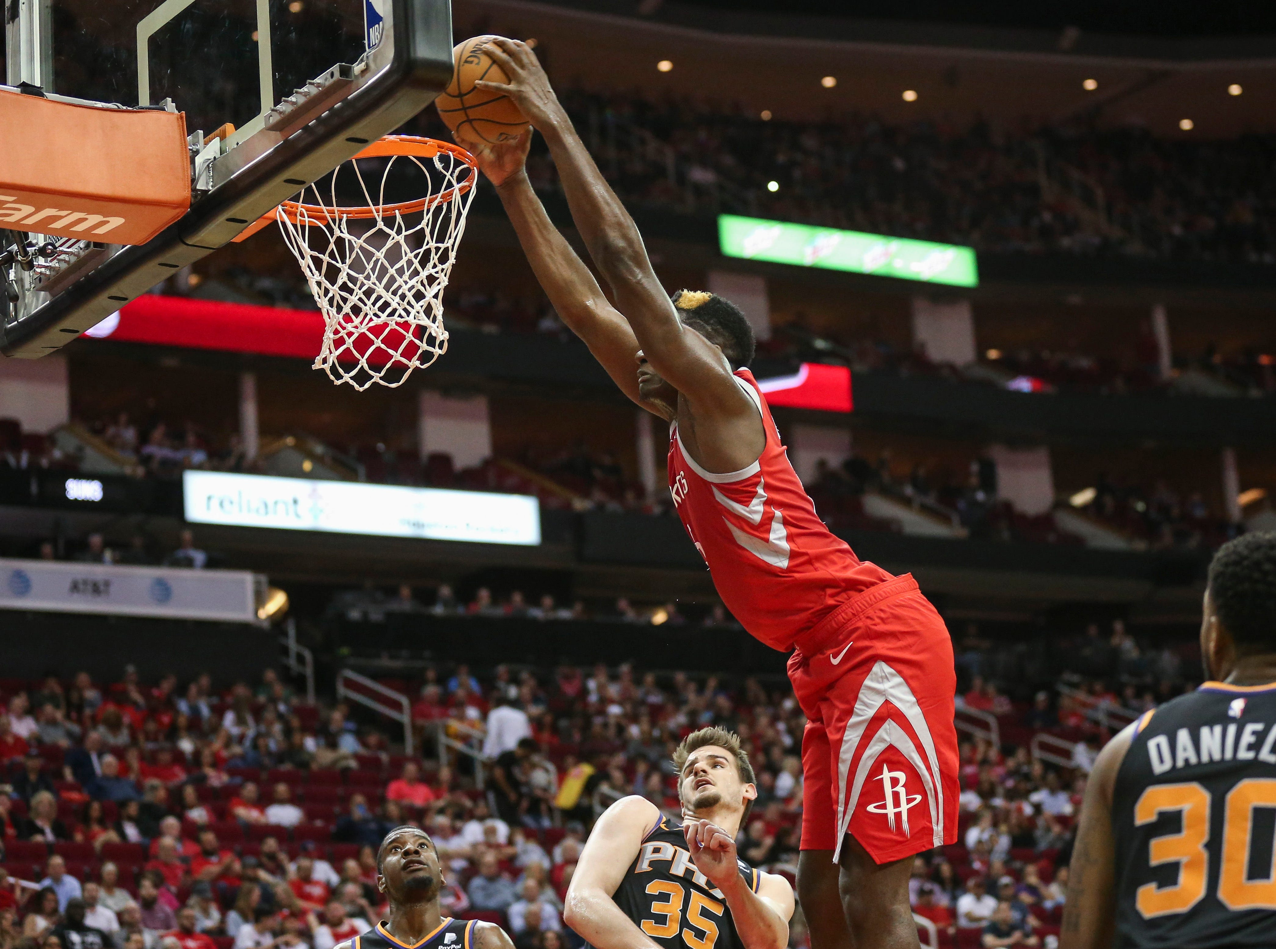 Apr 7, 2019; Houston, TX, USA; Houston Rockets center Clint Capela (15) dunks the ball during the second quarter as Phoenix Suns forward Dragan Bender (35) defends at Toyota Center. Mandatory Credit: Troy Taormina-USA TODAY Sports