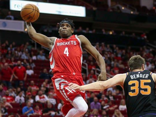 Rockets forward Danuel House Jr. (4) goes up for a dunk against Suns forward Dragan Bender (35) during a game on April 7.