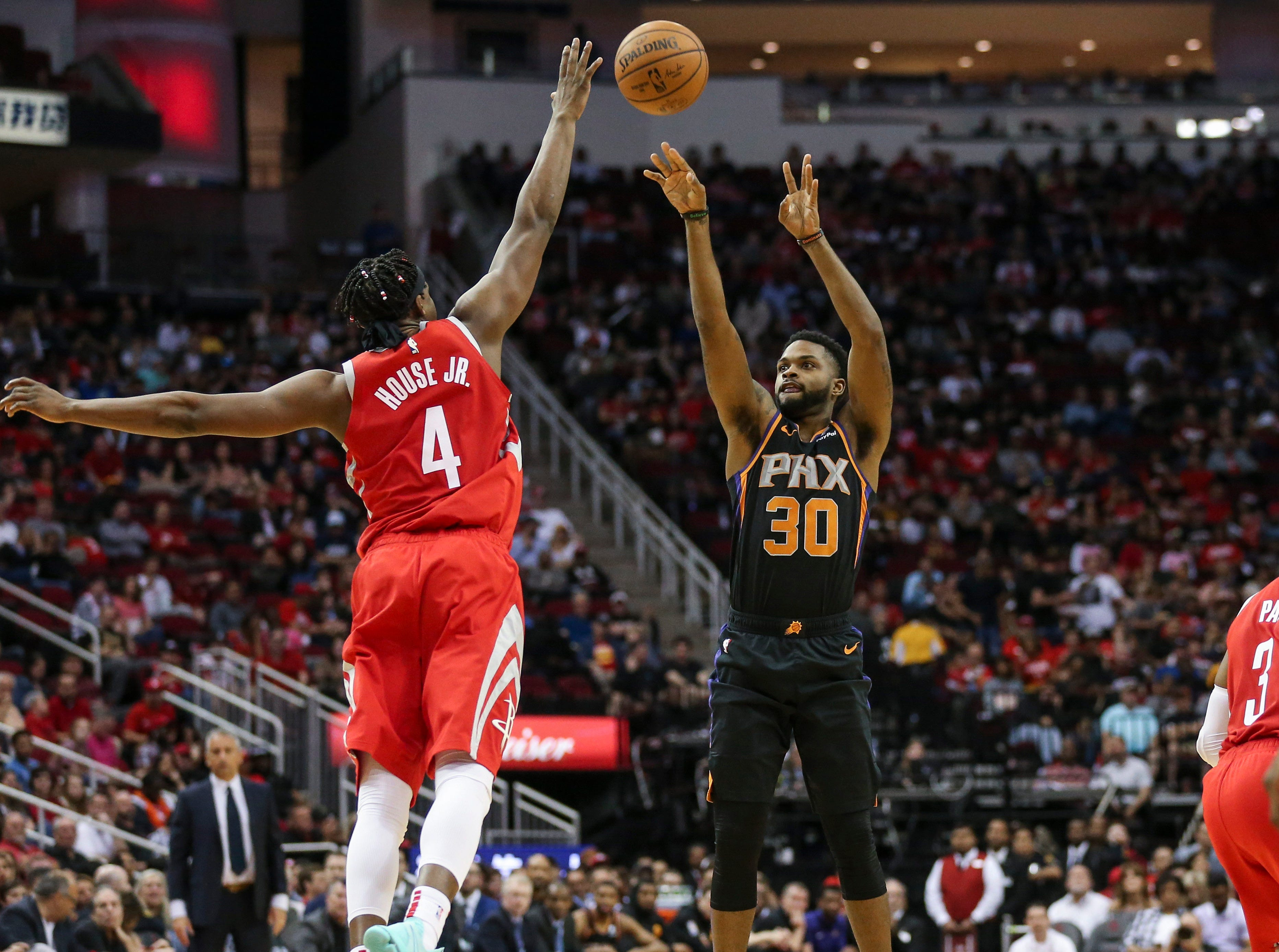 Apr 7, 2019; Houston, TX, USA; Phoenix Suns guard Troy Daniels (30) shoots the ball against Houston Rockets forward Danuel House Jr. (4) during the third quarter at Toyota Center. Mandatory Credit: Troy Taormina-USA TODAY Sports