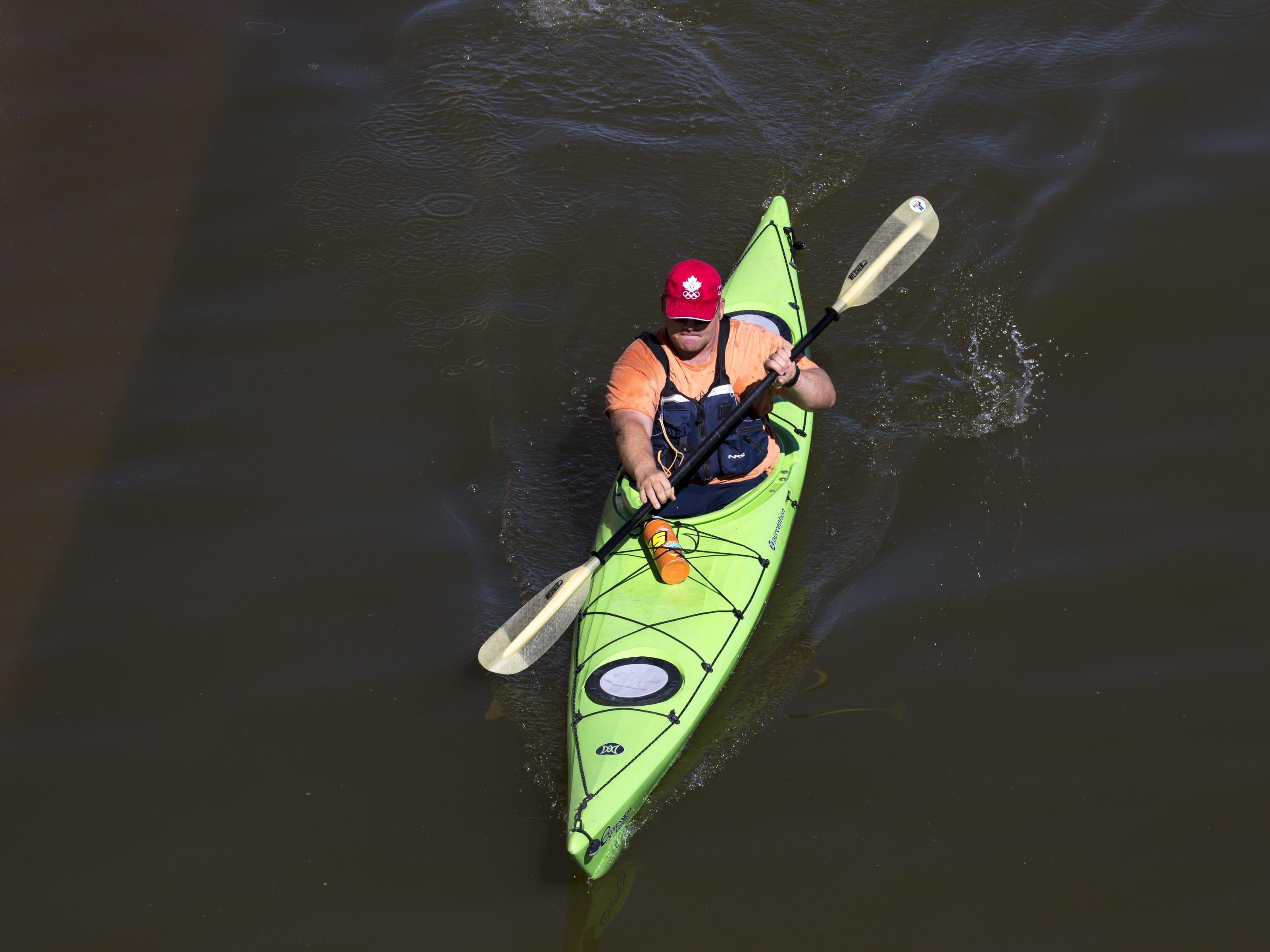 Ryan Allison kayaks on April 8, 2019, at Tempe Town Lake.