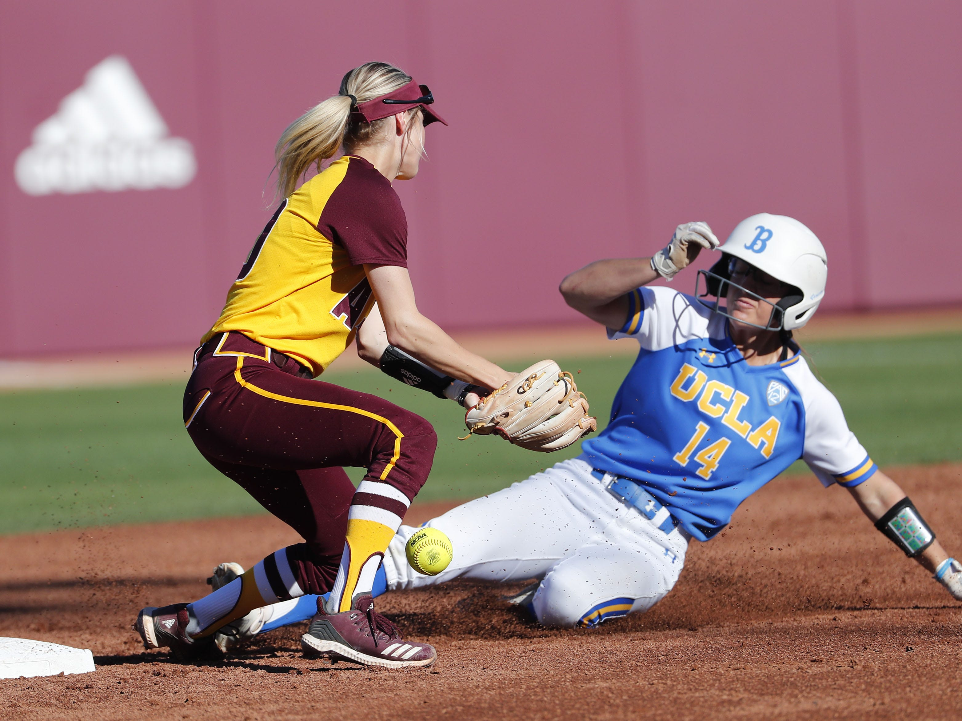 UCLA's Kelli Godin steals second base ahead of the tag by ASU's Bella Loomis during the second inning at Farrington Stadium in Tempe, Ariz. April 7, 2019.