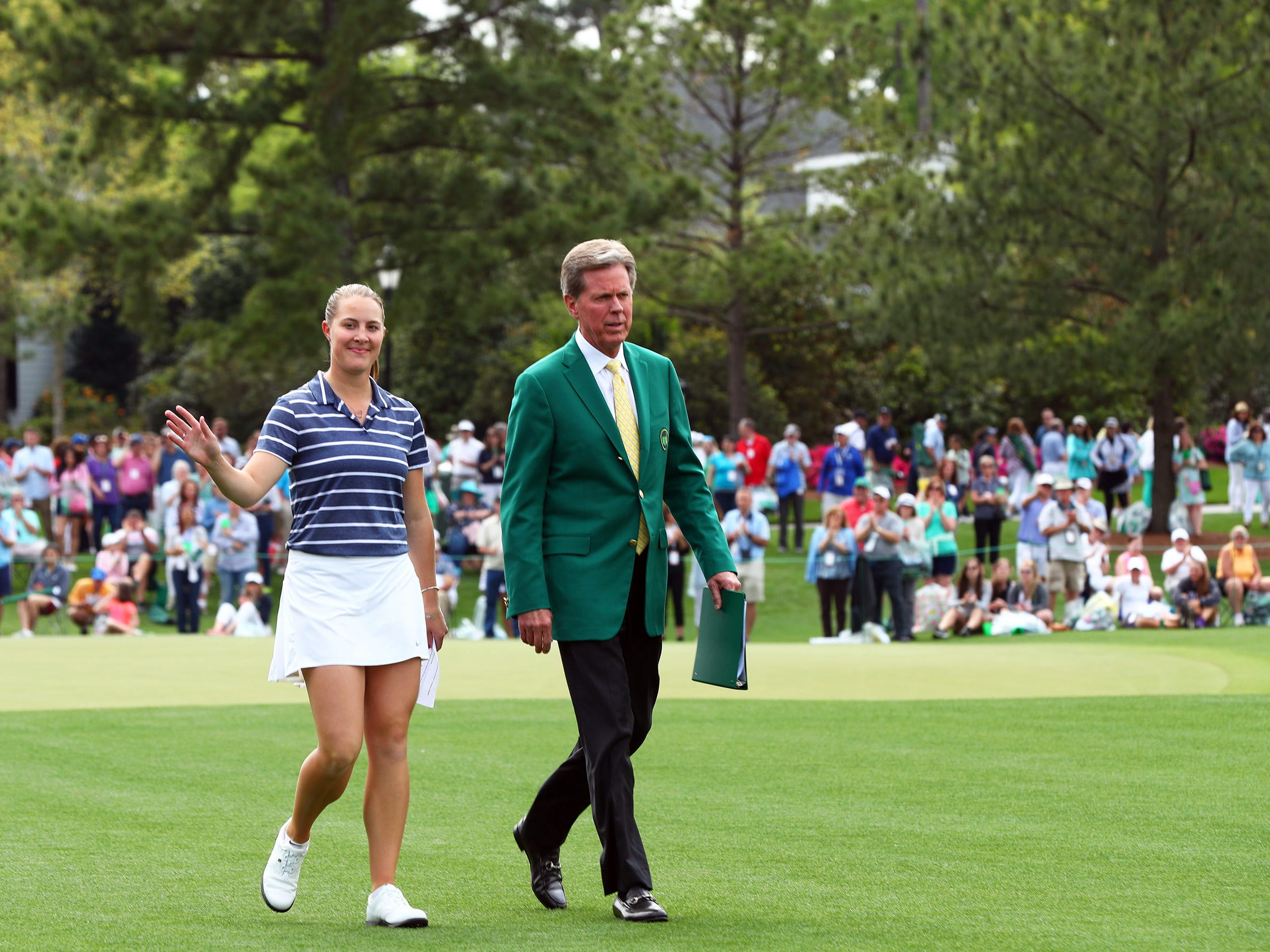 Apr 6, 2019: Jennifer Kupcho of Westminster, Colo. is escorted to the trophy presentation ceremony by Fred Ridley, Chairman of Augusta National Golf Club and the Masters Tournament (right) after winning the Augusta National Women's Amateur golf tournament at Augusta National GC.