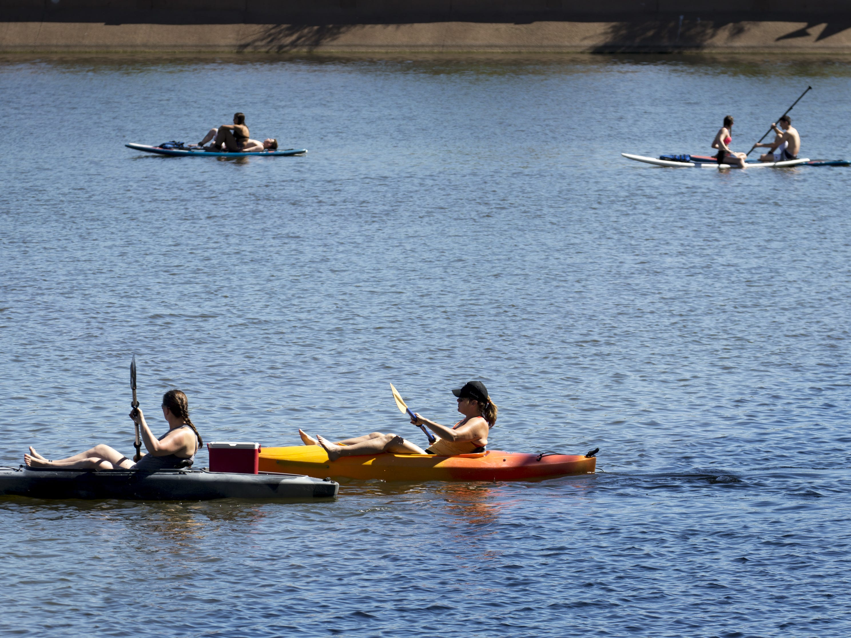 Kayakers and paddleboarders enjoy the weather on April 8, 2019, at Tempe Town Lake.