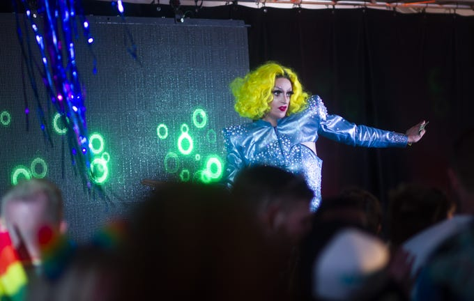 A drag queen performs in the VIP tent during Phoenix Pride at Steele Indian School Park on April 7, 2019.