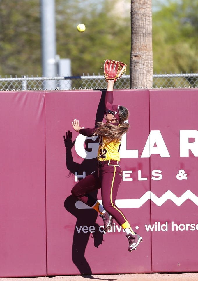 ASU right fielder Kindra Hackbarth reaches for a home run by UCLA's Briana Perez during the first inning at Farrington Stadium in Tempe, Ariz. April 7, 2019.