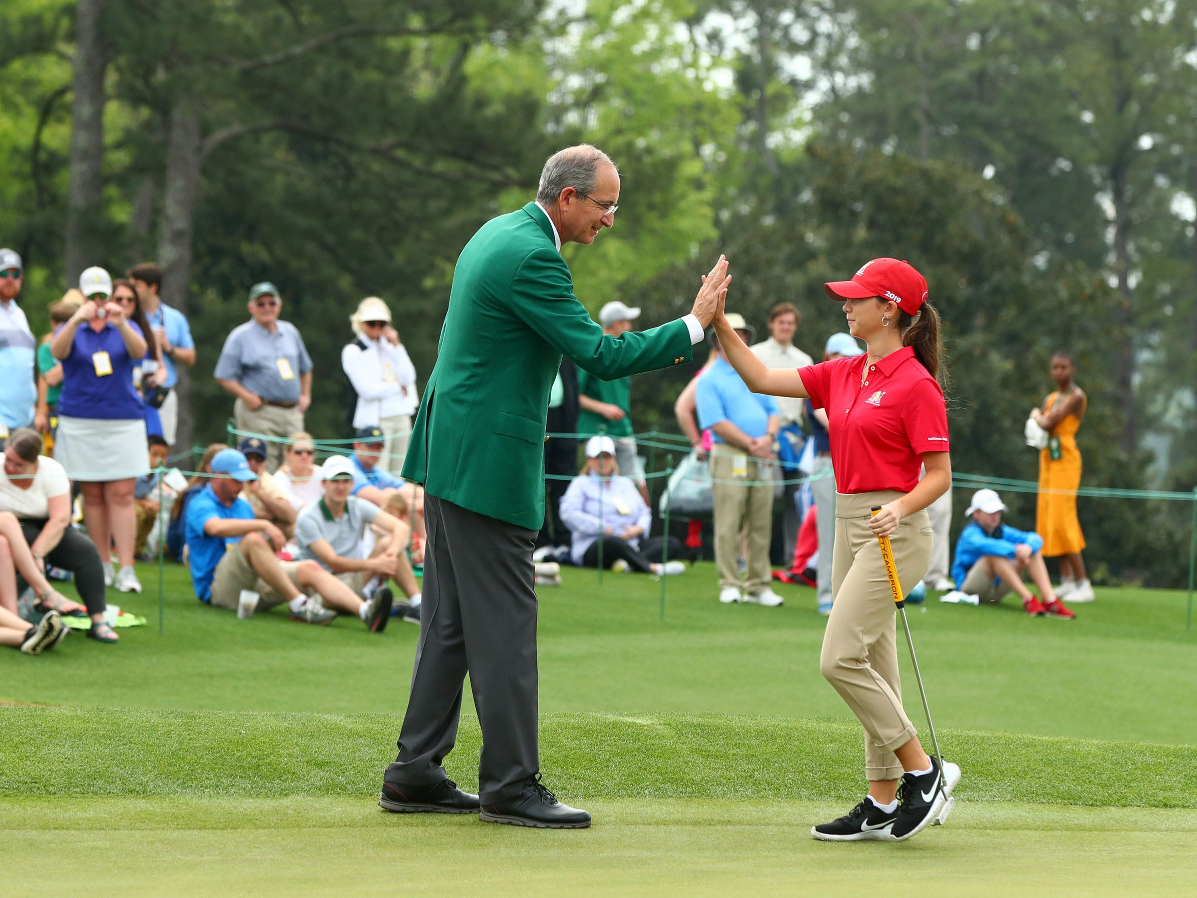 Apr 7, 2019: Hall of Fame golfer Nancy Lopez and Augusta National member Brian L. Roberts  congratulate Talia Rodino of Fort Myers, Fla. in the girls 14-15 age group during the finals of the Drive, Chip and Putt competition at Augusta National Golf Club.