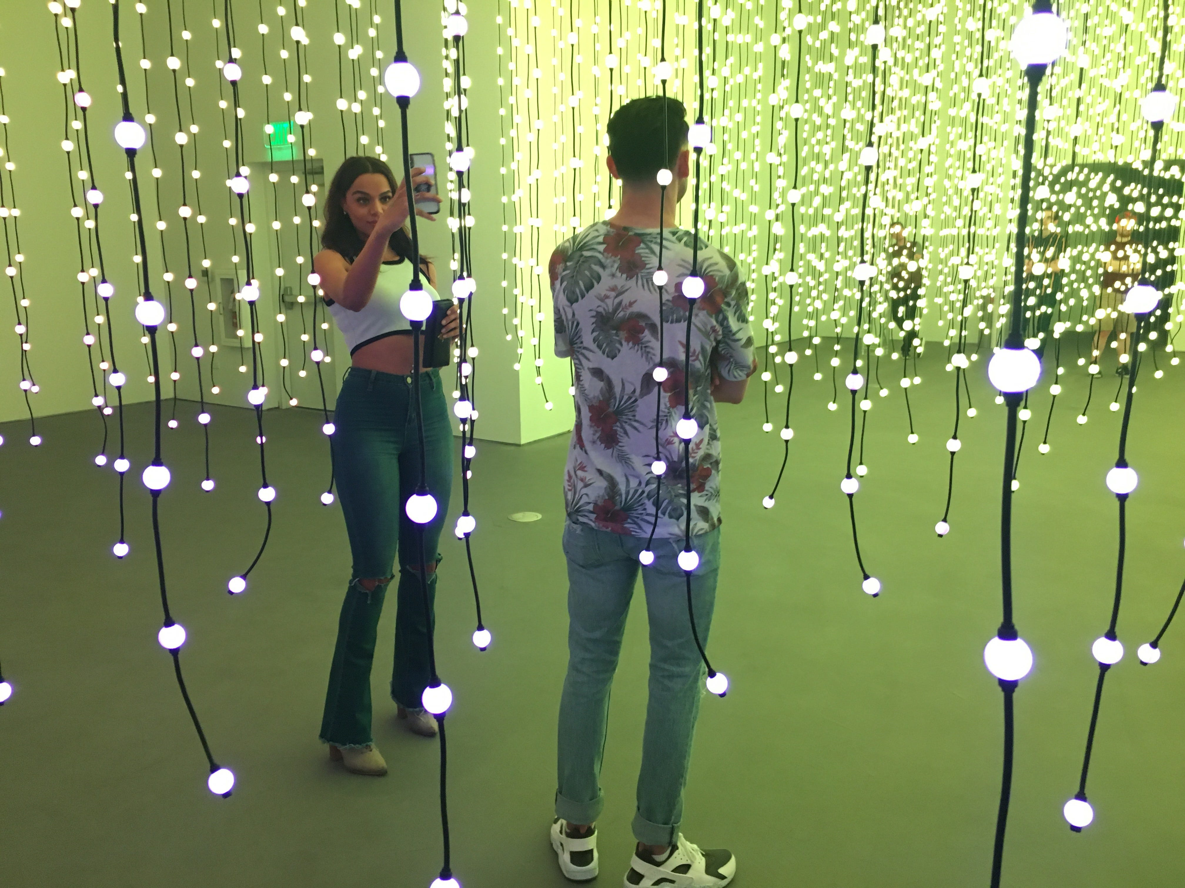 """Taelor Parker (left) and Michael Moreno explore the """"Submergence"""" art installation at Wonderspaces Arizona on April 5, 2019."""