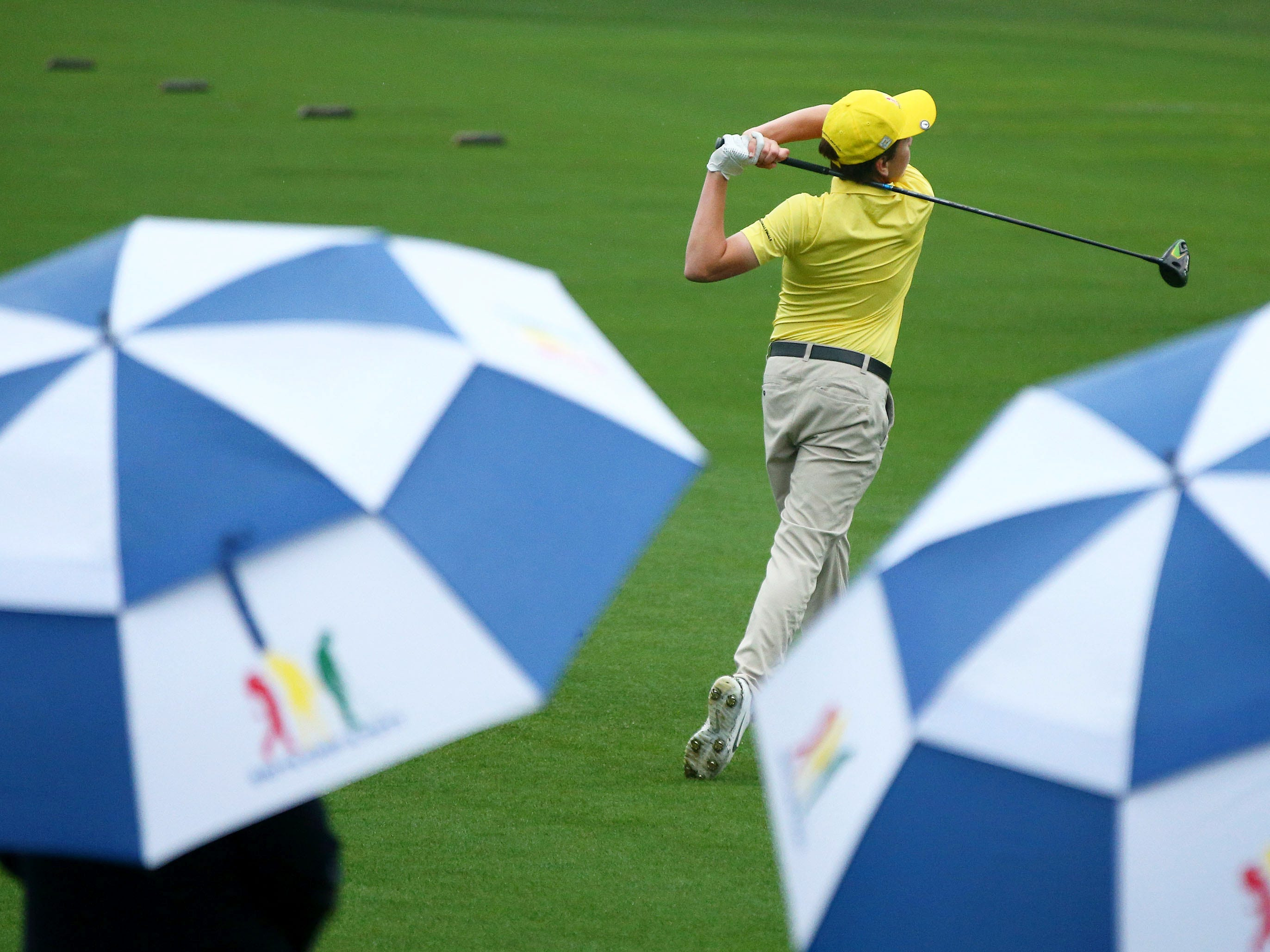 Apr 7, 2019; Augusta, GA, USA; Tyler Kowack of San Diego, Cali. hits his drive in the rain during the finals of the Drive, Chip and Putt competition at Augusta National Golf Club. Mandatory Credit: Rob Schumacher-USA TODAY Sports