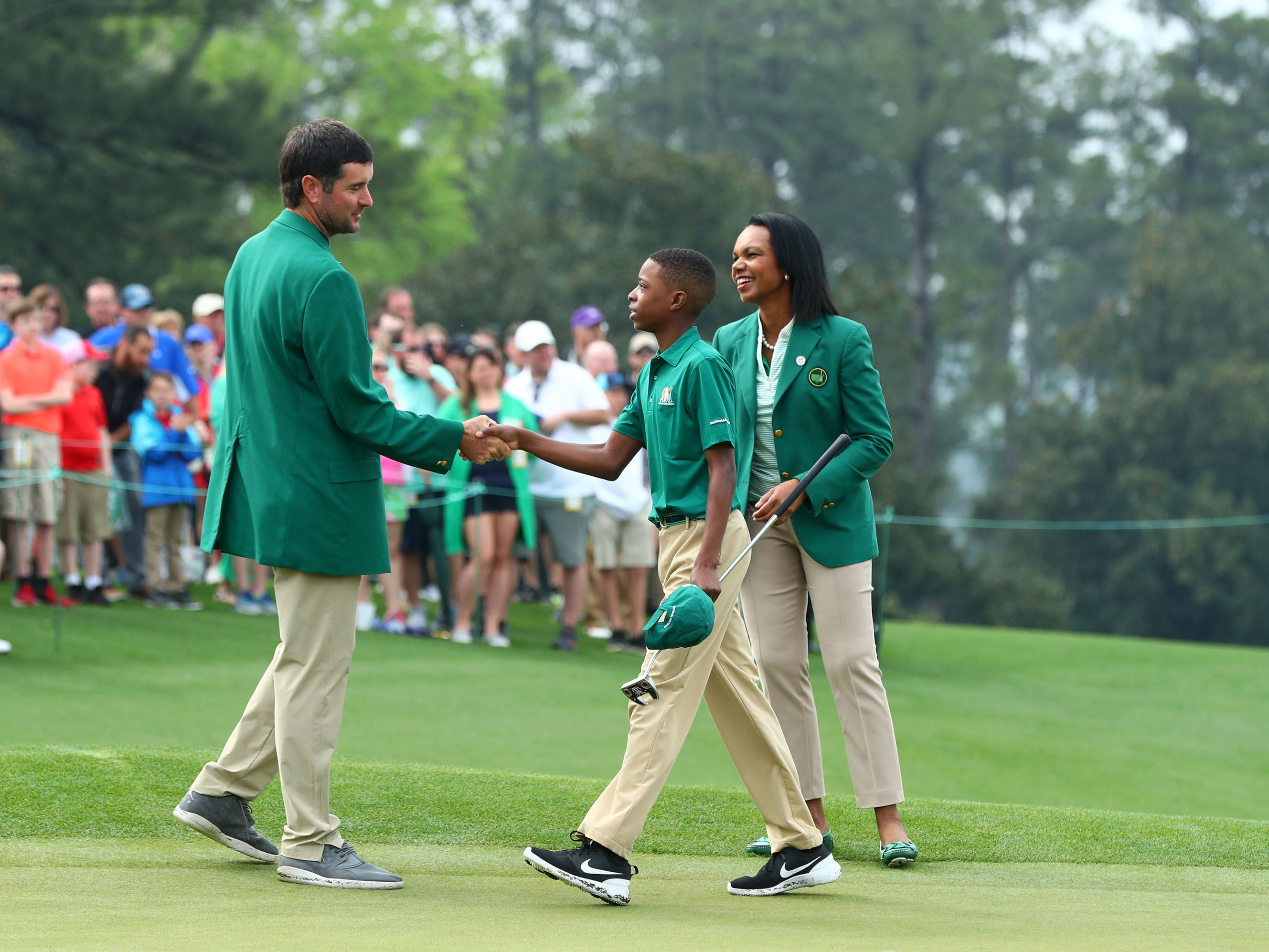 Apr 7, 2019; Augusta, GA, USA; Masters champion and Augusta National member Condoleezza Rice congratulate overall championÊMatthew Vital of Bethlehem, PA.Êfor the boys 11-12 age group during the finals of the Drive, Chip and Putt competition at Augusta National Golf Club. Mandatory Credit: Rob Schumacher-USA TODAY Sports