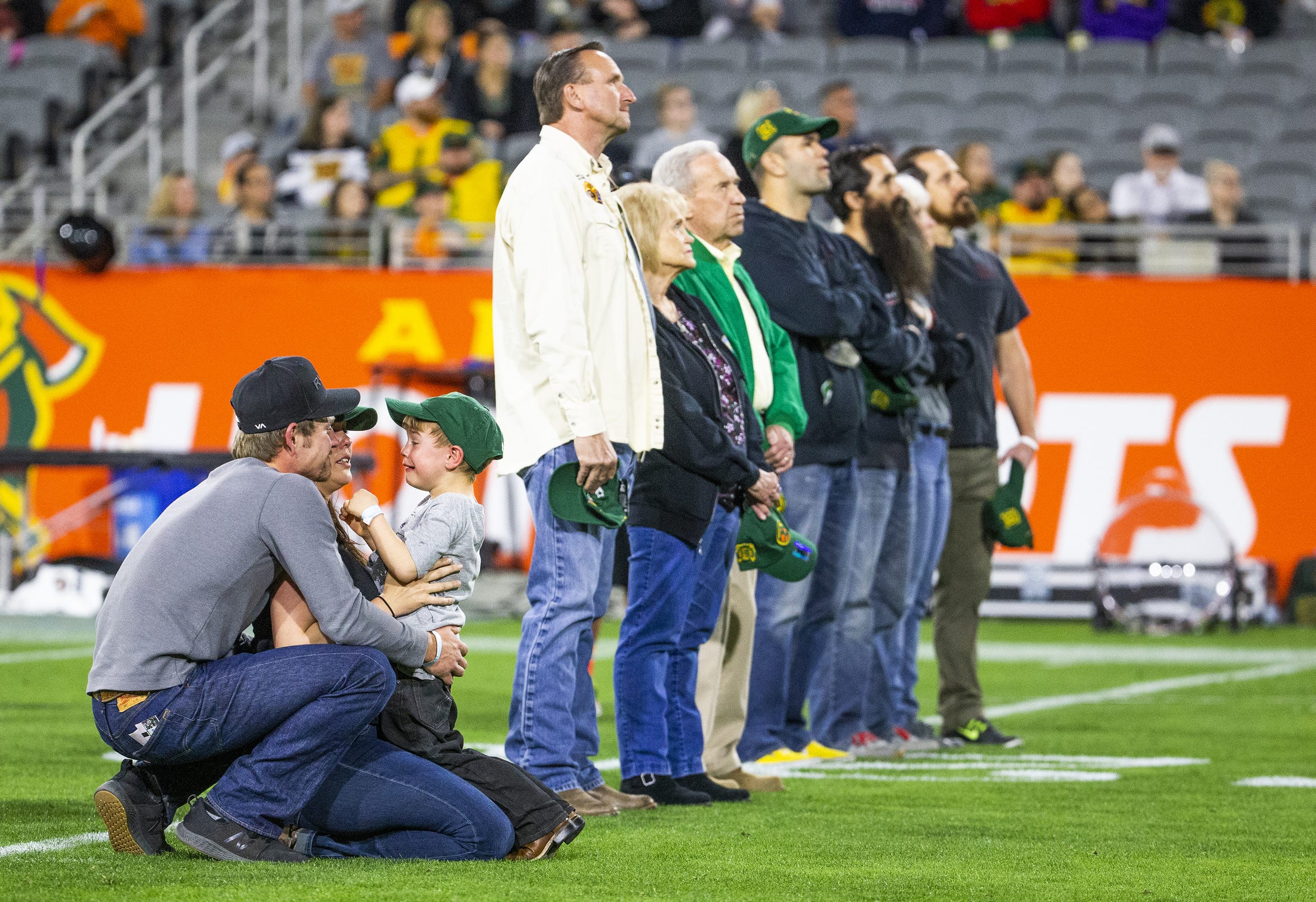Amanda Misner-Parker holds her son, Jaxon, with her husband, D.J. Parker, as he cries during a tribute to the Granite Mountain Hotshots by the Arizona Hotshots last month.