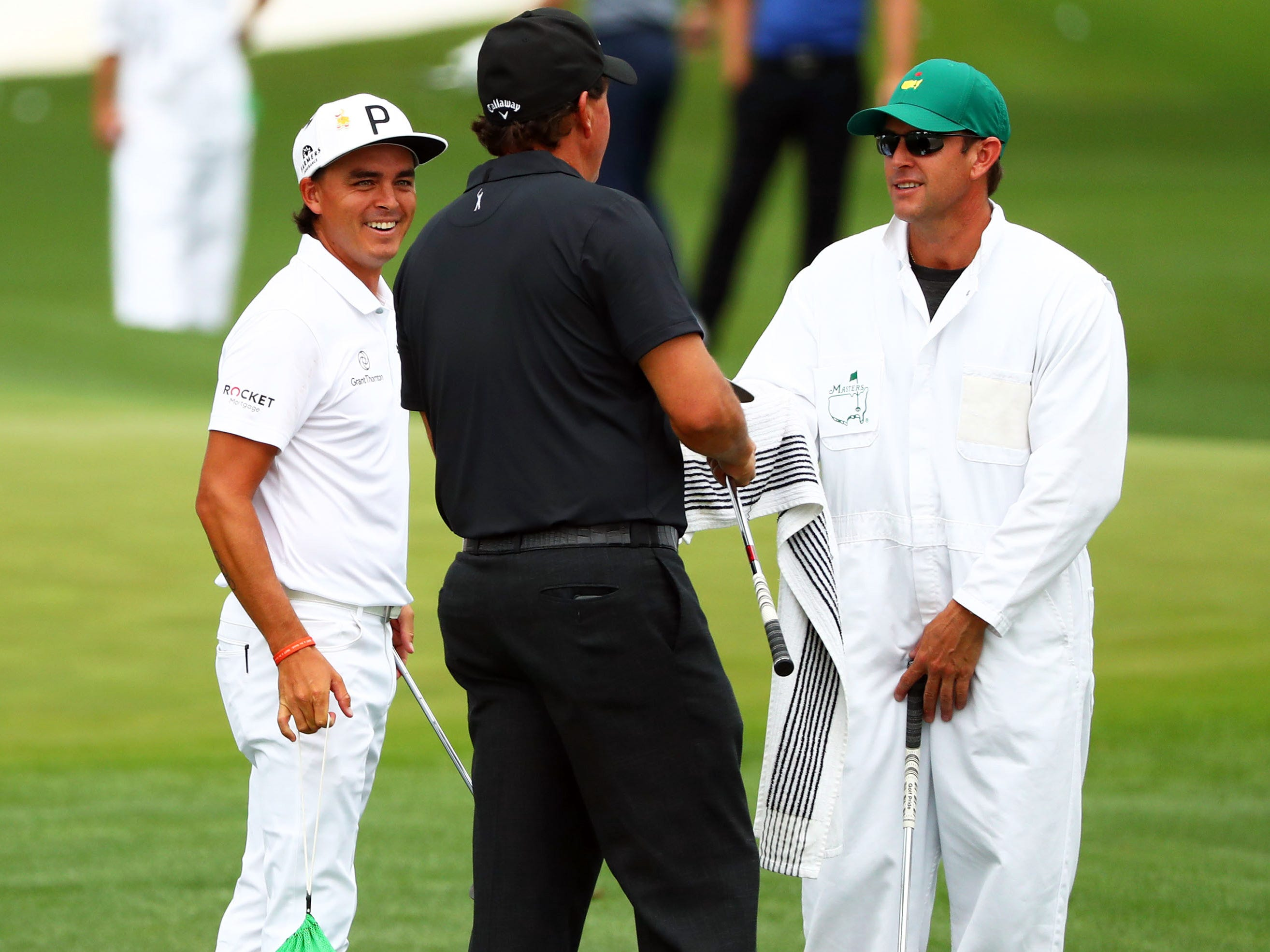 Apr 8, 2019; Augusta, GA, USA; Phil Mickelson talks to Rickie Fowler (left) at the practice facility during a practice round for the Masters golf tournament at Augusta National Golf Club.