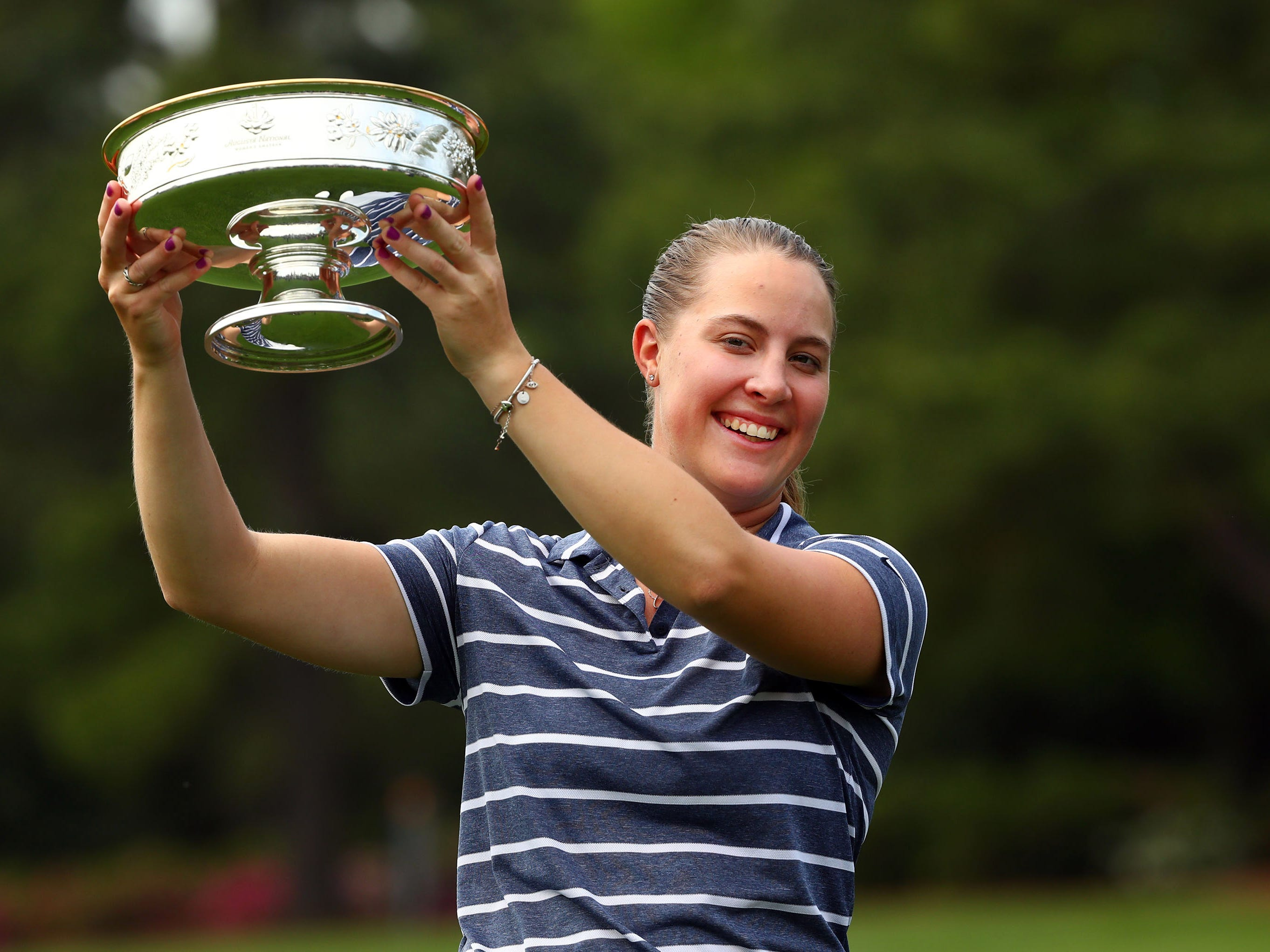 Apr 6, 2019; Augusta, GA, USA; Jennifer Kupcho of Westminster, Colo. holds-up the trophy after winning the Augusta National Women's Amateur golf tournament at Augusta National GC. Mandatory Credit: Rob Schumacher-USA TODAY Sports