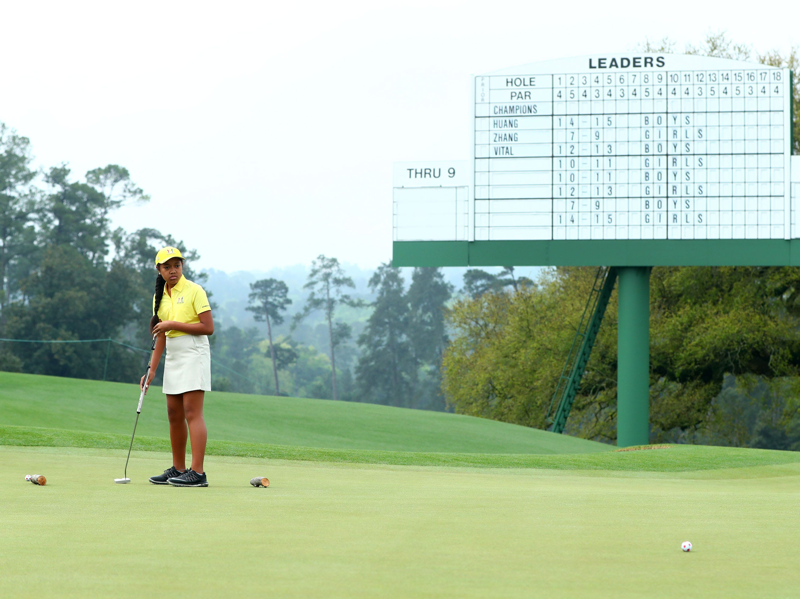 Apr 7, 2019: Alexis Vakasiuola of San Tan Valley, Ariz. in the girls 7-9 age group, watches her putt during the finals of the Drive, Chip and Putt competition at Augusta National Golf Club.