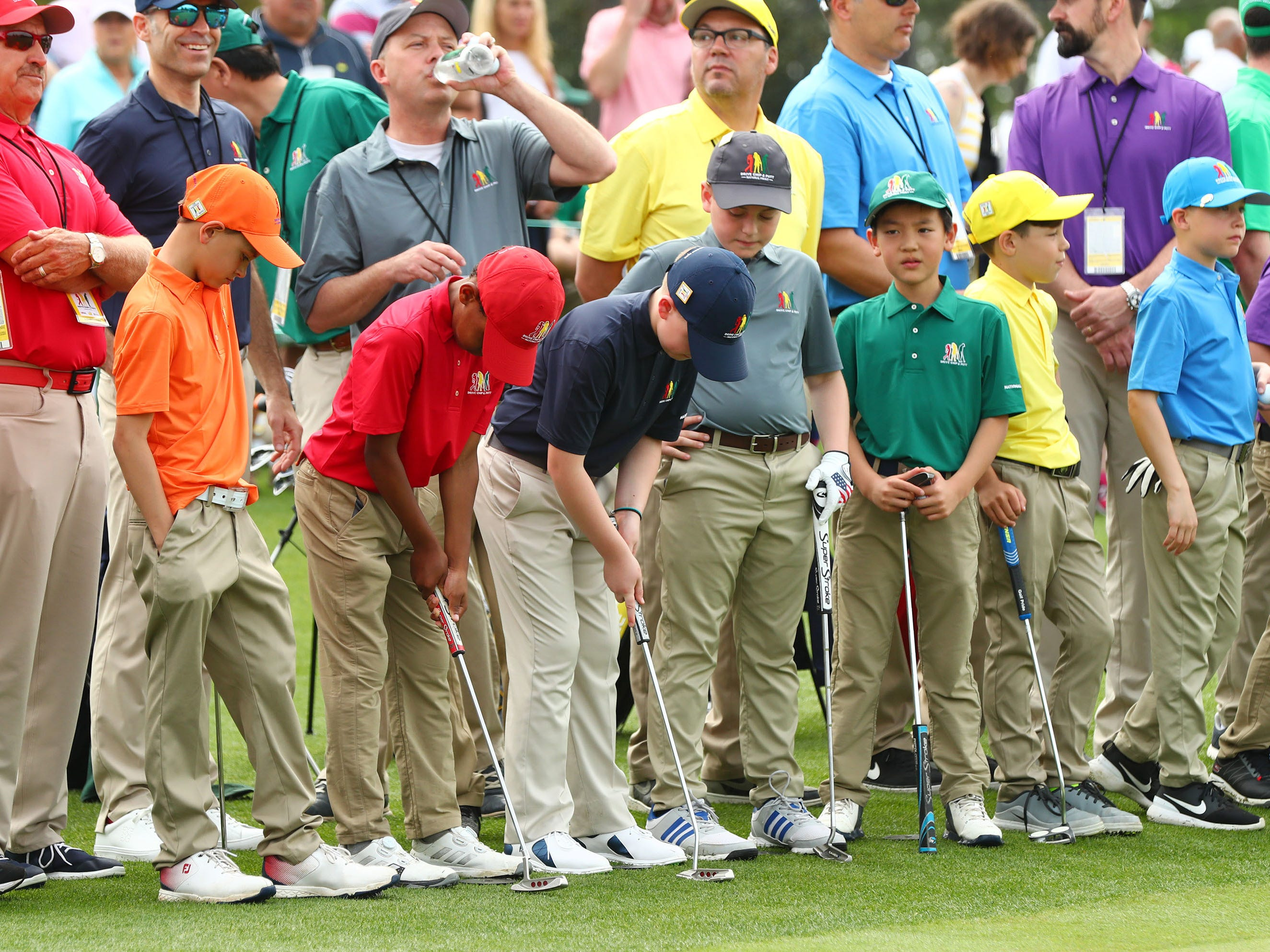 Apr 7, 2019; Augusta, GA, USA; The boys 7-9 age group prepare for their turn to putt during the finals of the Drive, Chip and Putt competition at Augusta National Golf Club. Mandatory Credit: Rob Schumacher-USA TODAY Sports