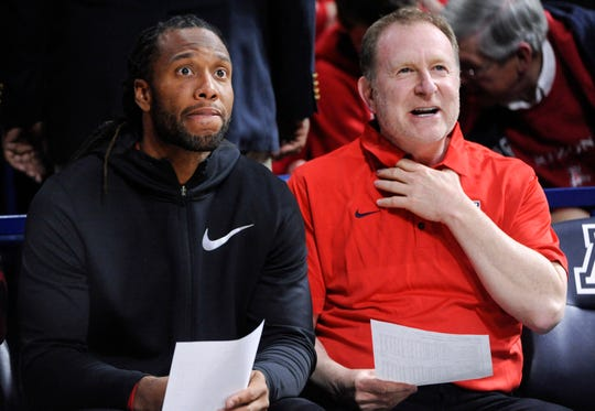 Arizona Cardinals wide receiver Larry Fitzgerald (11) (left) has reportedly been sitting in on interviews with Phoenix Suns owner Robert Sarver to help fill a front-office role with the NBA franchise.