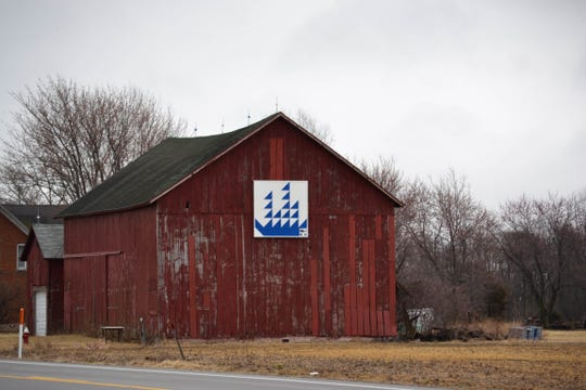 """The Country Slickers 4-H Club painted this barn quilt using the """"Voiliers"""" design. It hangs near Chet's Place campground on Ohio 163 in Port Clinton. This is one of seven barn quilts on display across the county. The Ottawa County Barn Quilt Trail committee hopes to hang 20 barn quilts by 2020."""