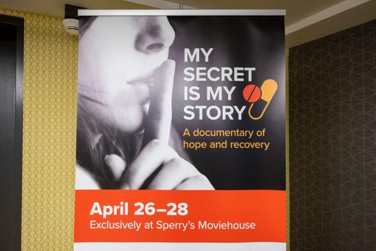 "An advertisement for ""My Secret Is My Story"" stands in the lobby of Sperry's Moviehouse. The film shares personal stories of opioid addiction and is scheduled to play at the theater later this month."