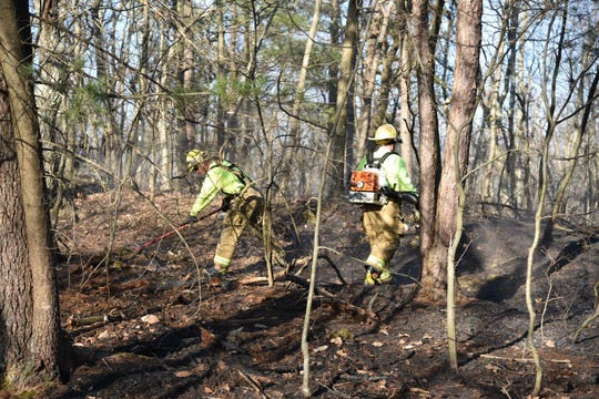 Firefighters respond to a brush fire off of Hilltop Road in Rhinebeck on Wednesday that burned an estimated four or five acres of land.