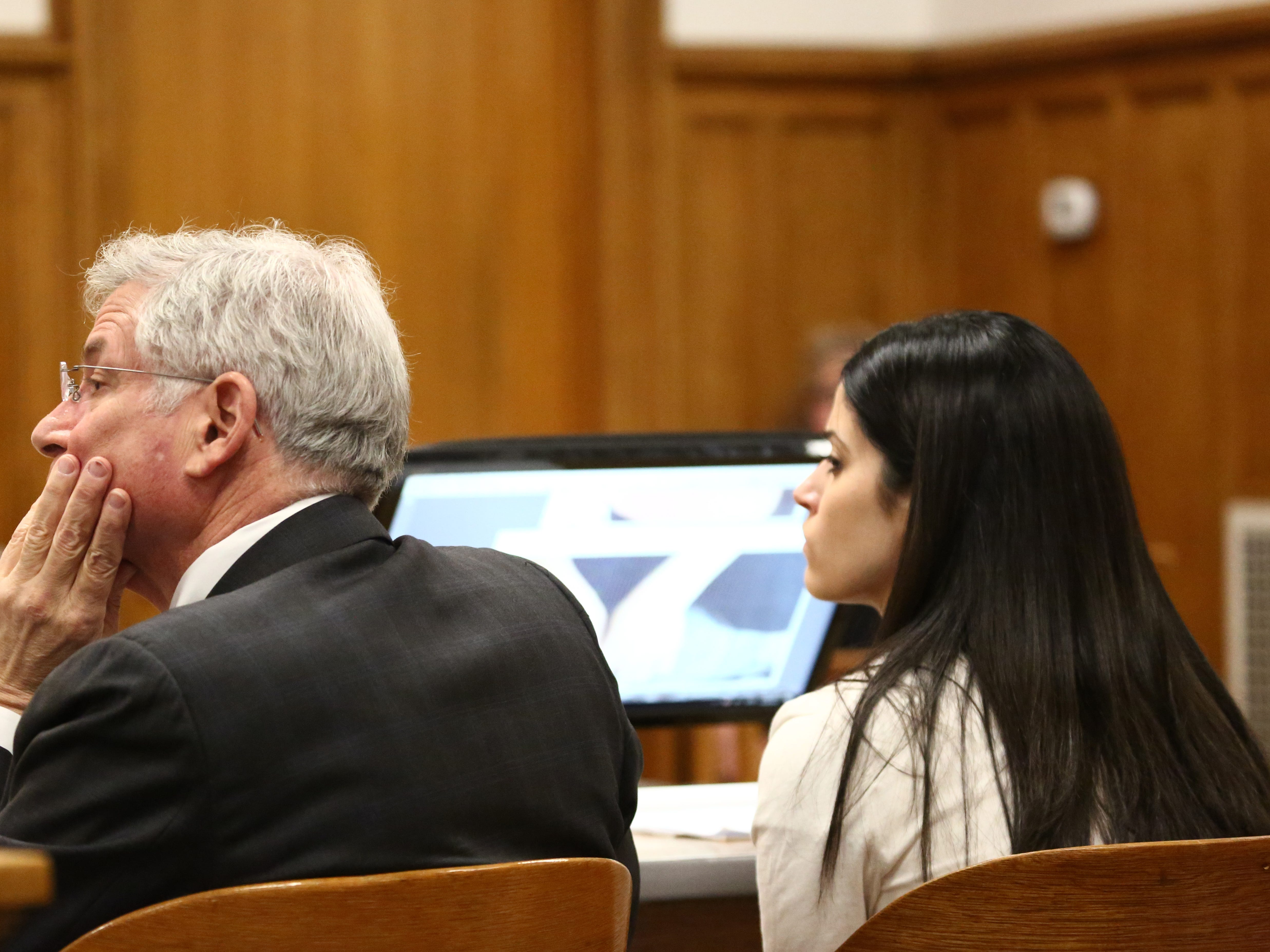 Nicole Addimando with part of her legal team, Benjamin Ostrer, while her other attorney John Ingrassia makes his closing arguments in Dutchess County Court on April 8, 2019.