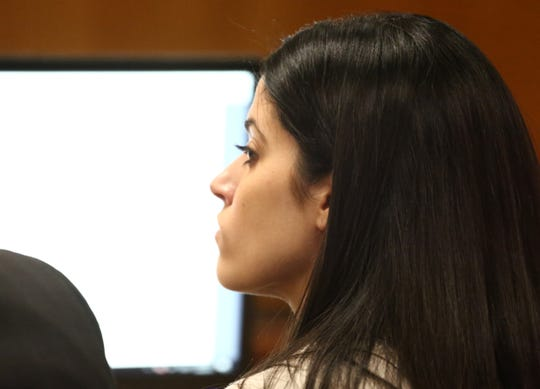 Nicole Addimando in court while her defense attorney John Ingrassia makes his closing arguments in on April 8, 2019.