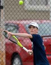 West York's Augie Citrone focuses on the ball while playing Josh Lynn of Hanover in the number one seed match, Monday, April 8, 2019.John A. Pavoncello photo
