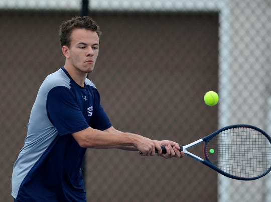 Jacob Landis of West York plays Jonny Martinez of Hanover in the numbest three seed match, Monday, April 8, 2019.