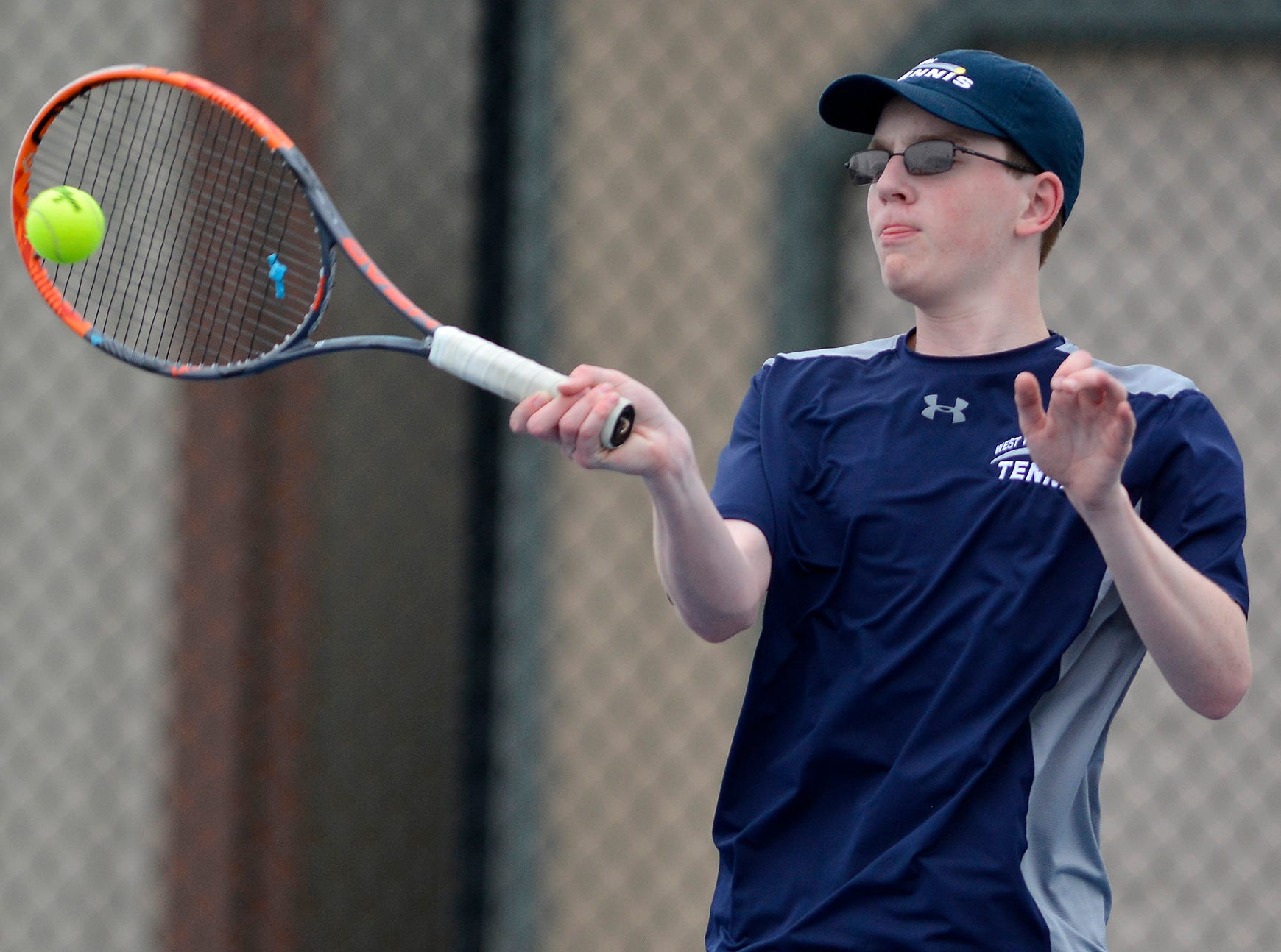 Jack Citrone of West York plays Antonio Corona of Hanover in the numbest two seed match, Monday, April 8, 2019.