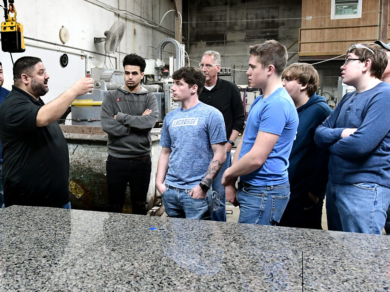Frank's Marble & Granite owner Carmine Pantano, left, presents a cutting demonstration to students during a tour of the Red Lion business during the York Builders Association 2nd Annual Construction Career Day Monday, April 8, 2019. The goal of the program is to raise student-awareness about local career opportunities in the construction field. Association members host the students. The association has planned similar events at various companies through April 17. Nine area high schools are participating in the program, according to the builders association. Bill Kalina photo