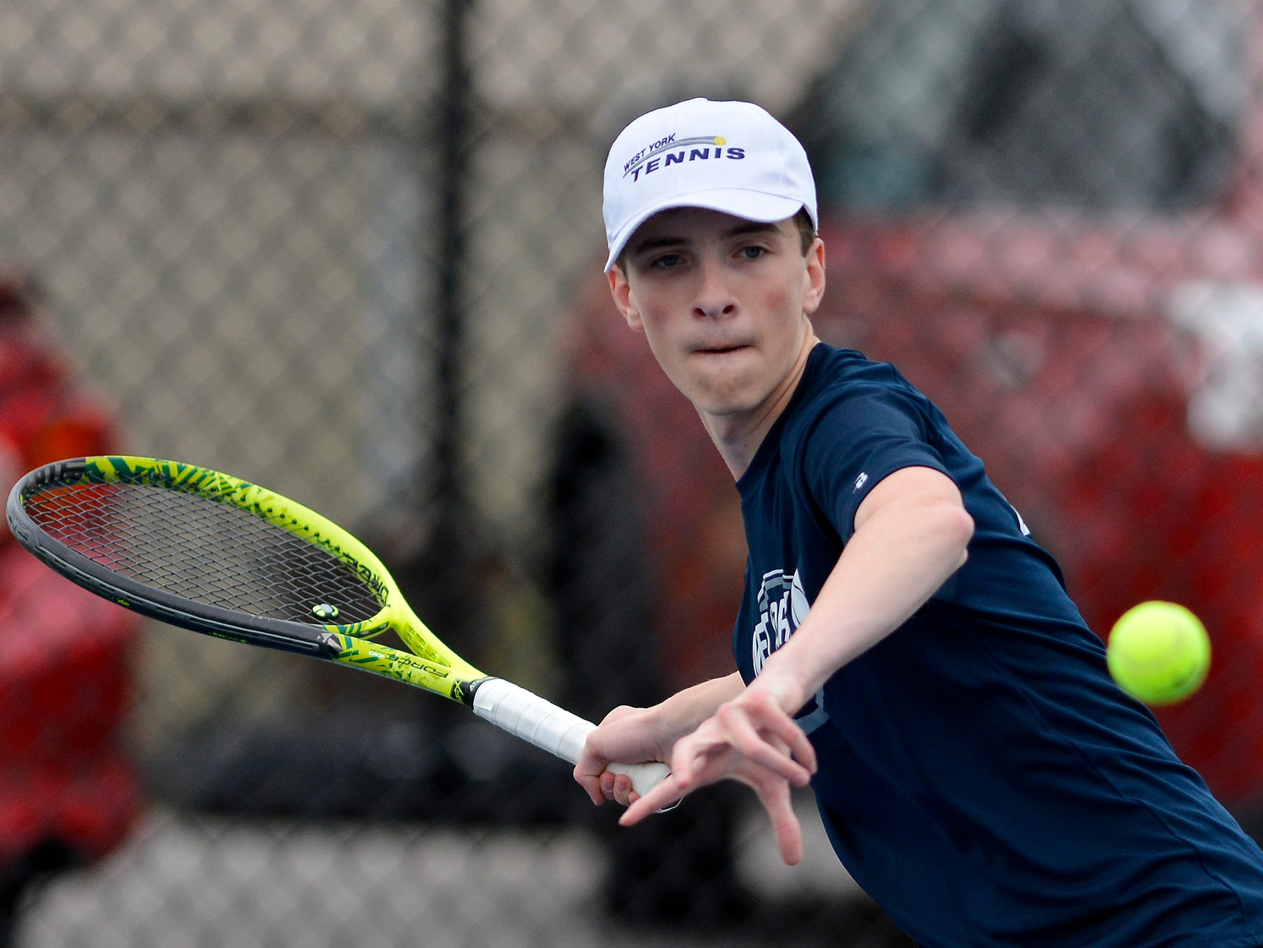 West York's Augie Citrone focuses on the ball while playing Josh Lynn of Hanover in the number one seed match, Monday, April 8, 2019.