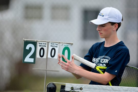 West York's Augie Citrone changes the score cards while playing Josh Lynn of Hanover in the number one seed match, Monday, April 8, 2019.John A. Pavoncello photo