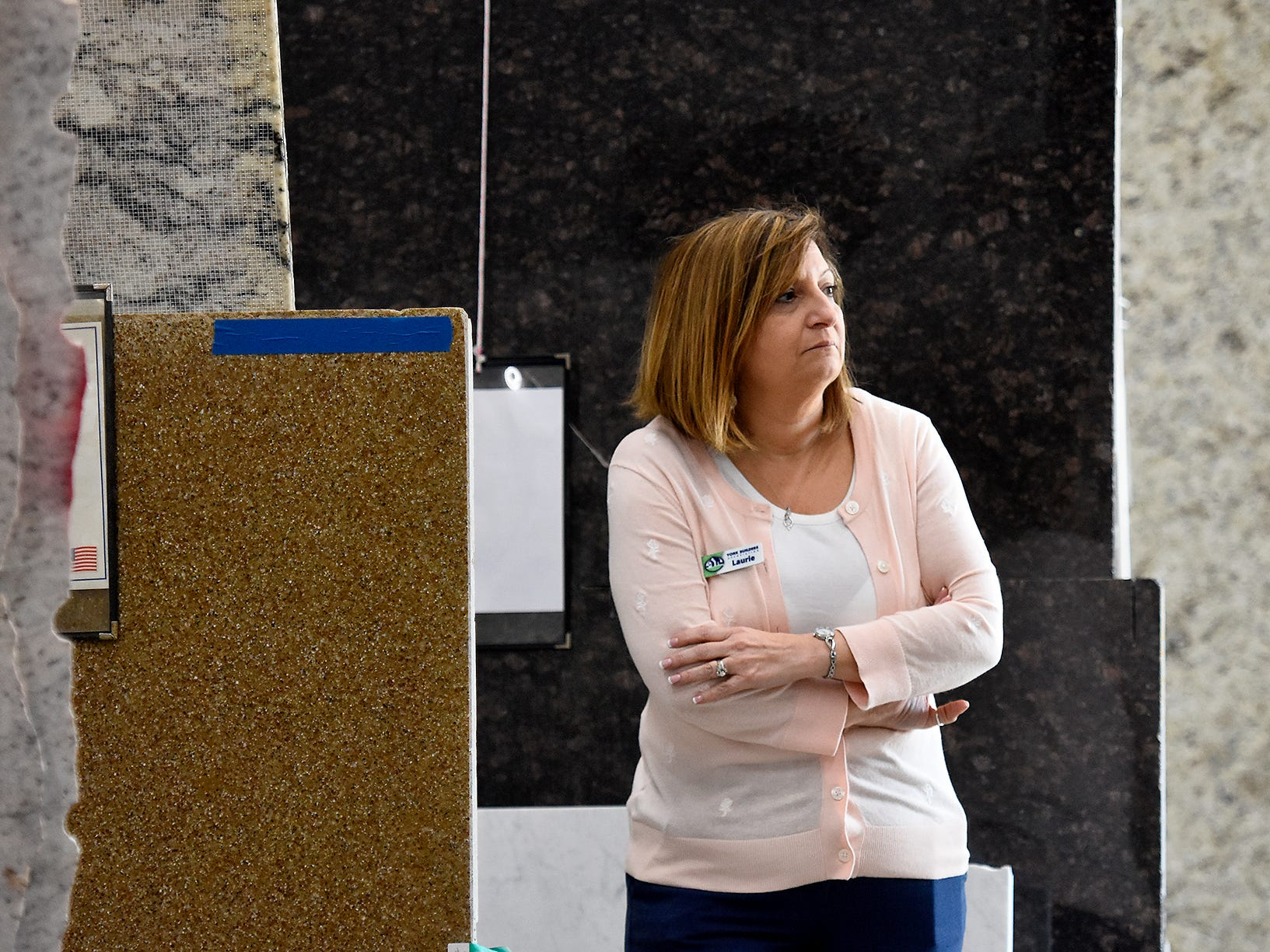 Laurie Lourie, York Builders Association Executive Officer, listens to a presentation at Frank's Marble & Granite, in Red Lion, during the association's 2nd Annual Construction Career Day Monday, April 8, 2019. The goal of the program is to raise student-awareness about local career opportunities in the construction field. Association members host the students. The association has planned similar events at various companies through April 17. Nine area high schools are participating in the program, according to the builders association. Bill Kalina photo