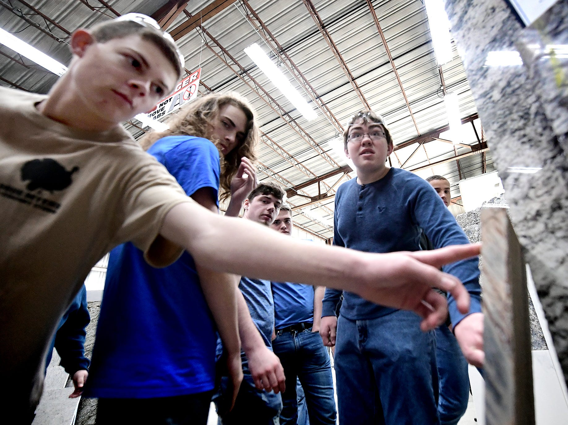 Spring Grove High School juniors, from left, Dylan Lawrence, Caleb Warren and Your Suburban junior Drew Davis touch a stone sample at Frank's Marble & Granite, in Red Lion, during the York Builders Association 2nd Annual Construction Career Day Monday, April 8, 2019. The goal of the program is to raise student-awareness about local career opportunities in the construction field. Association members host the students. The association has planned similar events at various companies through April 17. Nine area high schools are participating in the program, according to the builders association. Bill Kalina photo