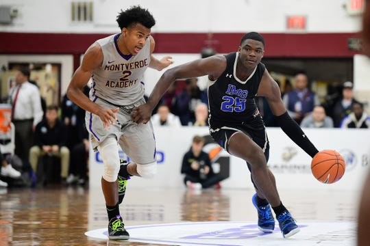 IMG Academy Ascenders guard Jarace Walker (25) drives the ball past Montverde Academy Eagles guard Moses Moody (2) during the first quarter at Christ the King High School.