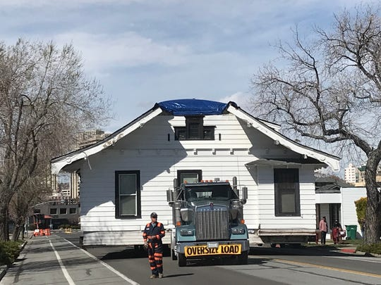 On April 7, 2019, the 1908 Humphrey House approaches its new location on South Arlington Avenue after being moved over 7 hours from UNR's Gateway District.
