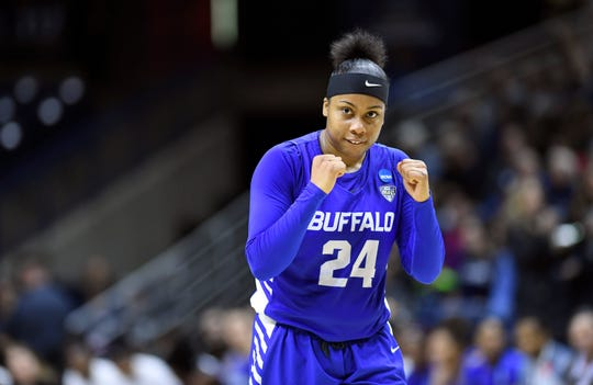 Buffalo's Cierra Dillard (24) pumps her fist at the buzzer after defeating Rutgers in a first-round game in the NCAA women's college basketball tournament, Friday, March 22, 2019, in Storrs, Conn.