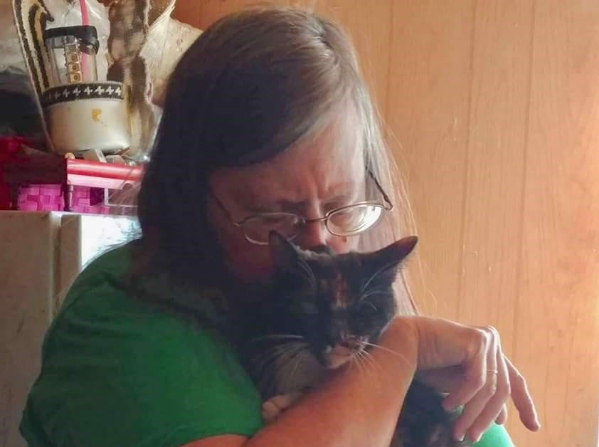 Judy Henderson of Redding welcomed home Millie the cat after losing her at an evacuation center during the Carr Fire in July.