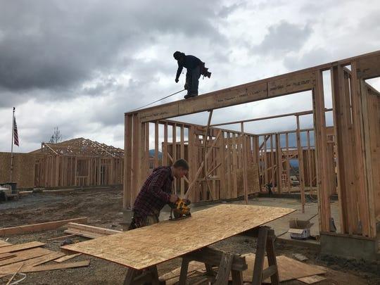 Crews with Jones Construction work on framing Randy Ledbetter Sr.'s home in Lake Keswick Estates.