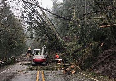 Crews work to clear trees on Highway 58 near Oakridge on Monday, April 8, 2019.