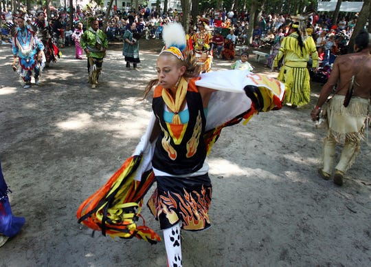 Carissa Miller of Millsboro, a member of the Nanticoke Tribe, performs a fancy dance during an inter-tribal dance at the 36th annual Nanticoke Indian Powwow near Millsboro.