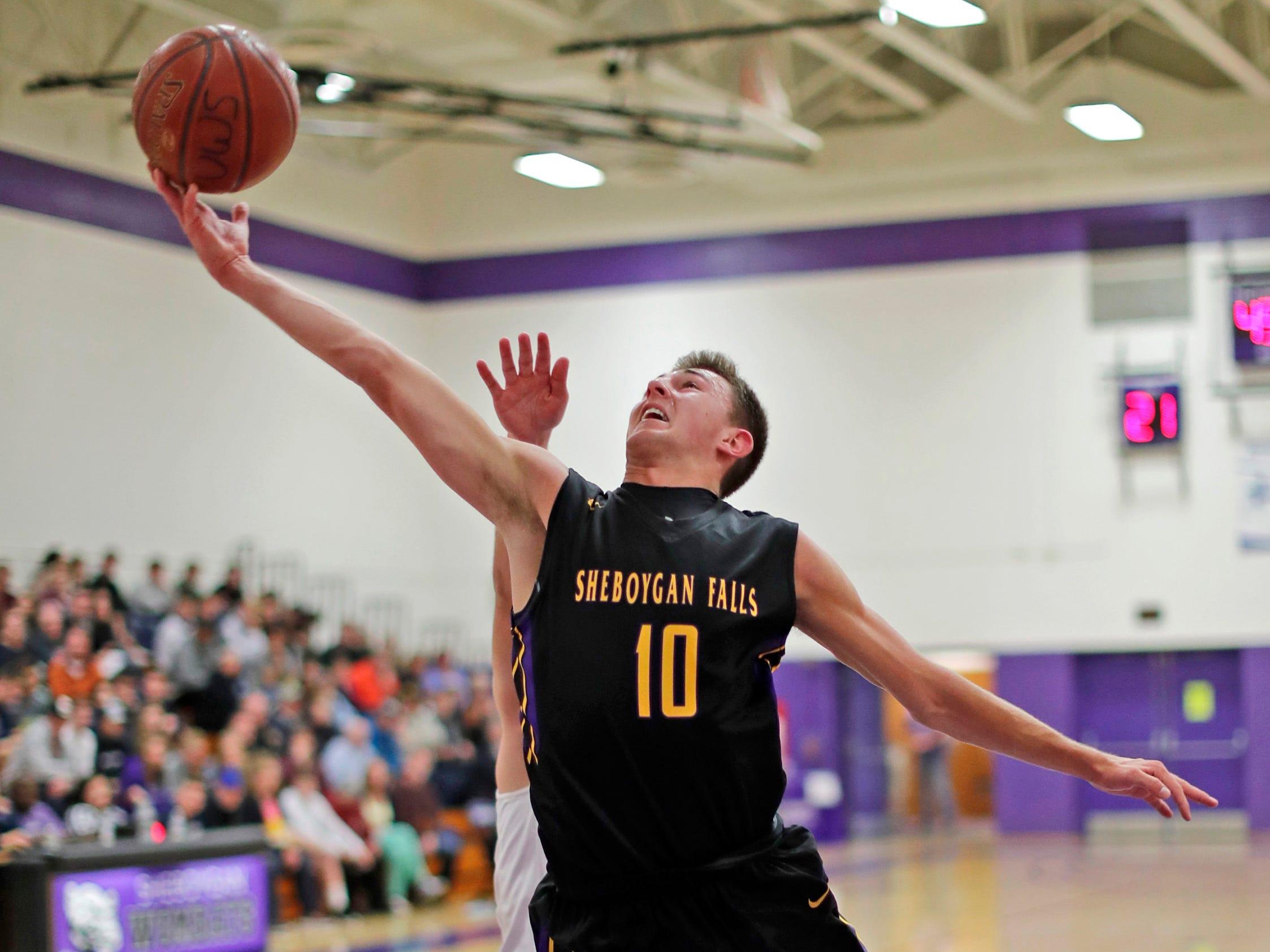 Sheboygan Falls' Justin Tenpas (10) drives to the basket, during the Sheboygan Area Senior All-Stars game, at UW-Sheboygan, Sunday, April 7, 2019, in Sheboygan, Wis.