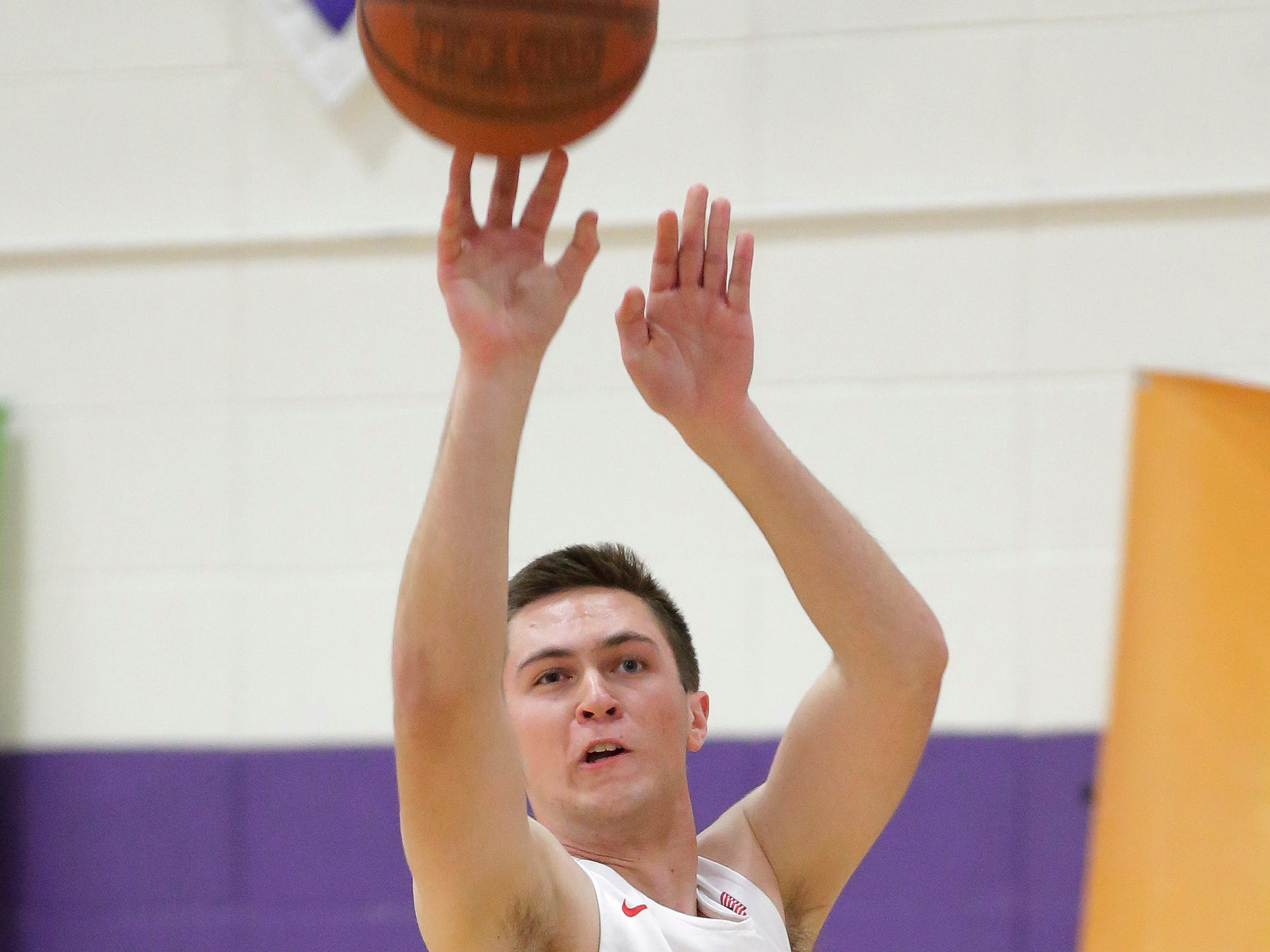 Sheboygan South's Nick Larson (20) aims a three point during the three-point contest before the Sheboygan Area Senior All-Stars game, at UW-Sheboygan, Sunday, April 7, 2019, in Sheboygan, Wis. Larson took top honors in the competition.