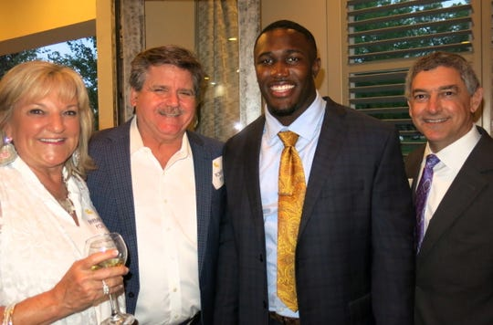 Barbara and Robert Pou, LSU Linebcker Devin White Louisiana Commissioner of Administration Jay Dardenne at governor's reception.