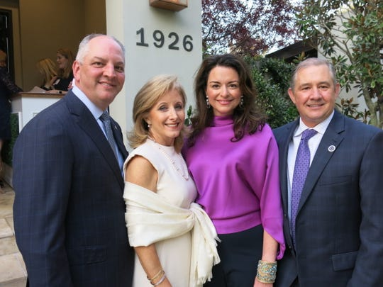 Louisiana Gov. John Bel Edwards and First Lady Donna Edwards, hosts Brandi Daigle and hubby Chuck Daigle, CEO of the Ochsner LSU Health Shreveport, at party for the Edwards at the Daigles' Provenance  home.